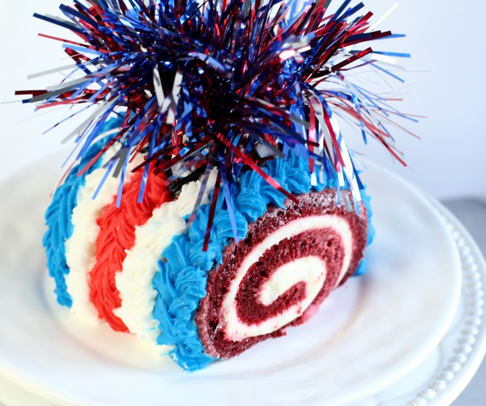 Firecracker Cake Roll - red velvet cake roll with red, white, and blue icing and cake topper